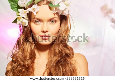 Radiant beauty in floral wreath - stock photo