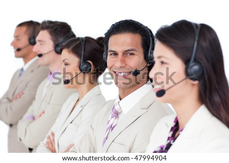 Radiant business woman and her team lining up against a white background - stock photo