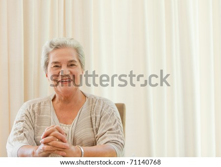 Radiant woman looking at the camera - stock photo