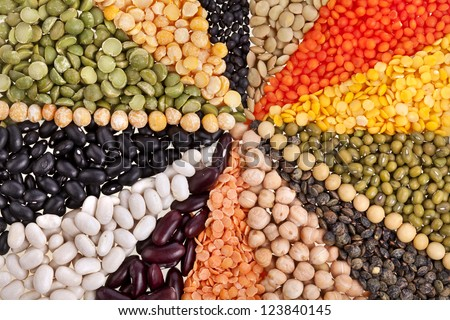 radiate texture background , rays of different beans, legumes, peas, lentils
