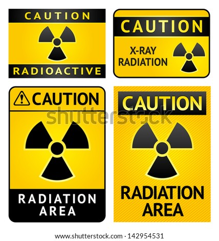 Radiation hazard stickers, four labels. Rasterized versions (copy of the my vector) - stock photo