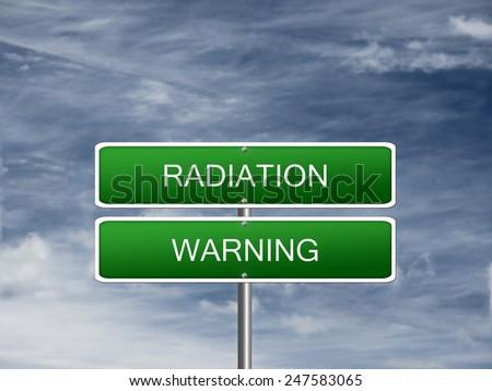 Radiation radioactive warning alert sign dark sky. - stock photo
