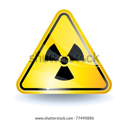 Radiation sign with glossy yellow surface - stock photo