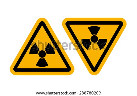 Radiation signs with glossy yellow surface - stock photo