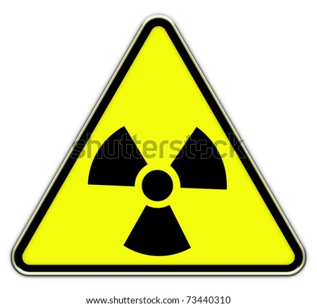 Radiation triangle sign on yellow background - stock photo