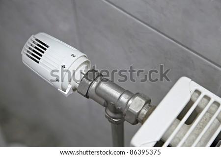 Radiator adjusting knob, heating system - stock photo
