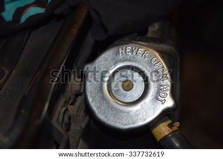 radiator cap with warning to never open hot - stock photo