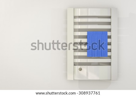 radiator heats a home bathroom - stock photo
