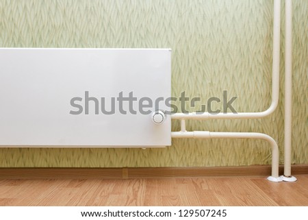 radiator of a central heating in the apartment - stock photo