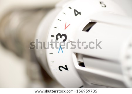 Radiator thermostat / heating cost - stock photo