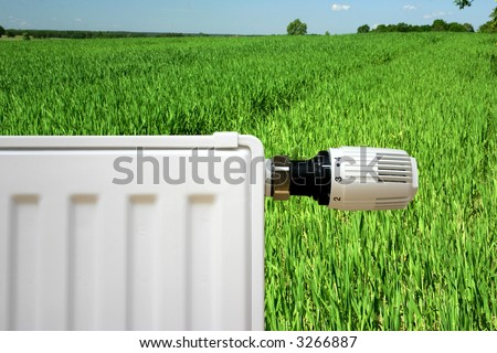 Radiator with thermostat set optimal on a young green grain