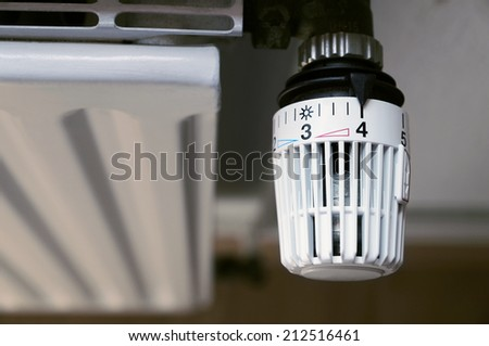radiator with thermostat temperature controller - stock photo