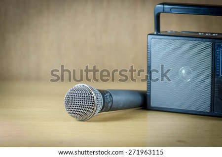 radio and microphone on table old style photo. - stock photo