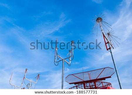 Radio antenna and secondary radar at airport - stock photo