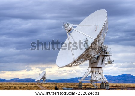 Radio antenna dishes of the Very Large Array radio telescope in New Mexico. - stock photo