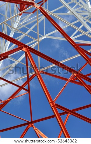 radio antenna tower structure against blue sky- vertical - stock photo