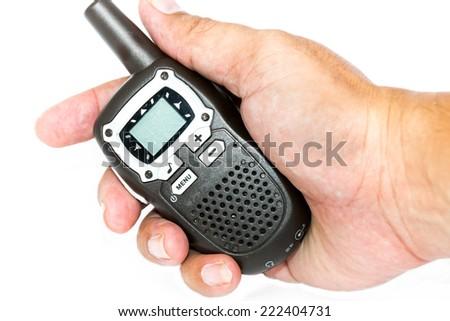 Radio communication on hand on white background - stock photo