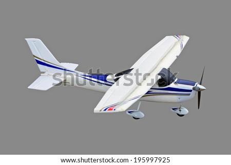 Radio controlled plane isolated on grey background. - stock photo