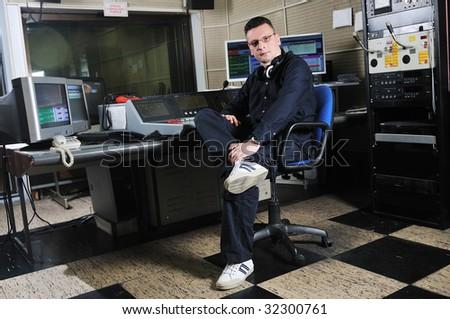 radio dj man indoor at radio studio - stock photo