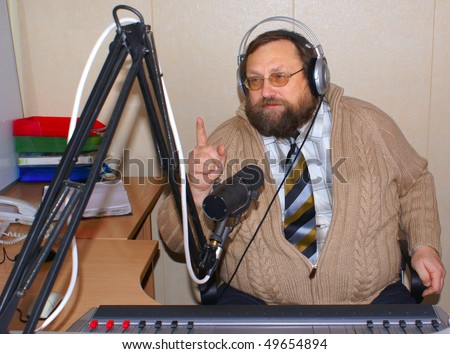 Radio DJ  with microphone and big headphone.