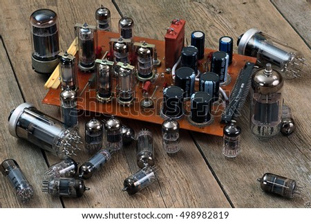 radio lamps and transistors on a wooden table