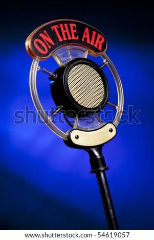 radio microphone on blue background - stock photo