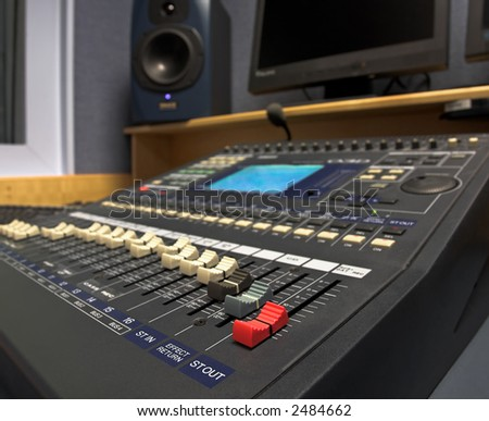 Radio production studio mixing desk - stock photo