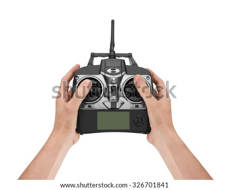 Radio remote control in hand, isolated on white background - stock photo