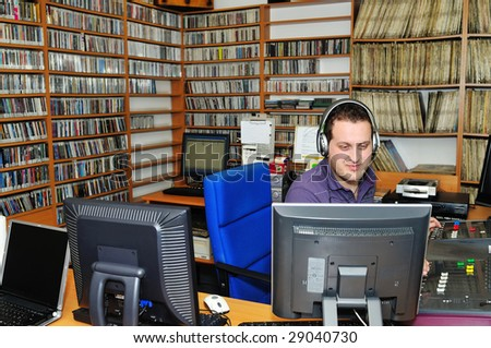radio station dj reading news and info - stock photo
