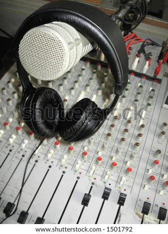 Radio studio detail: microphone, headphones and mixer - stock photo