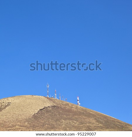 Radio telecommunications tower on top of an old volcano in Lanzarote, Spain - stock photo