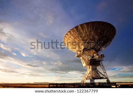 Radio telescope against dramatic sky at the National Radio Astronomy Observatory in Socorro, New Mexico - stock photo