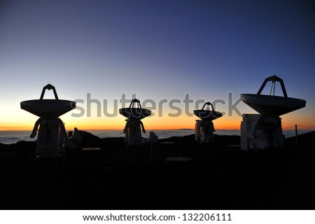 Radio telescope dishes at sunset. This is the Submillimeter Array on Mauna Kea, Hawaii. - stock photo