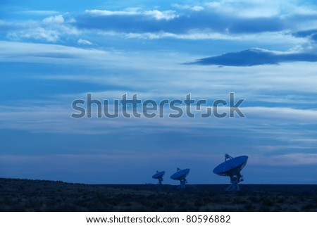 Radio telescopes at the Very Large Array (VLA) in New Mexico, USA, at dusk
