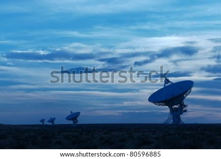 Radio telescopes at the Very Large Array (VLA) in New Mexico, USA, at dusk - stock photo