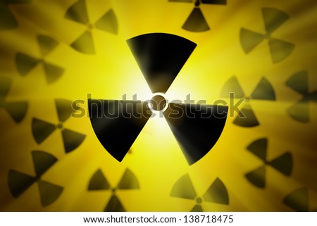 Radioactive danger symbol with a shine yellow background. - stock photo