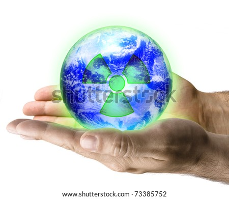 Radioactive earth in male hand isolated on white - stock photo