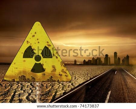Radioactivity sign and the city - stock photo