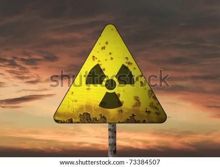 Radioactivity sign and the dramatic sky - stock photo