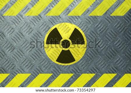 Radioactivity sign on metal - stock photo