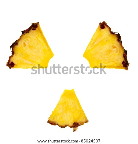 Radioactivity symbol made from pineapple pieces over white background. - stock photo