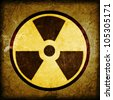 radioactivity symbol on a grungy barrel background - stock photo