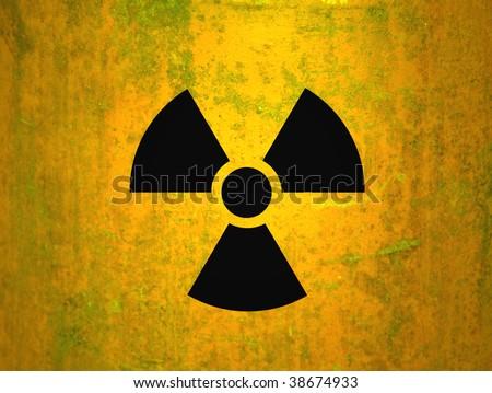 radioactivity symbol on a yellow grungy barrel background - stock photo