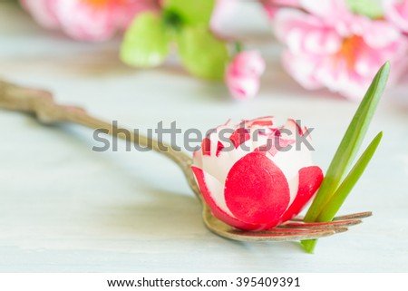Radish and chives on the fork spring food background concept - stock photo