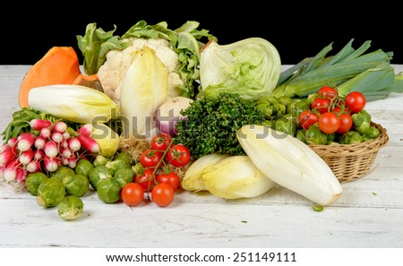 radish, Brussels sprouts, endive, cabbage, tomatoes, parsley, pumpkin and leek - stock photo