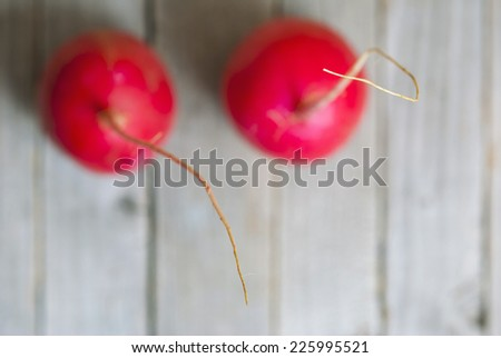 radishes on wooden background, focus on root