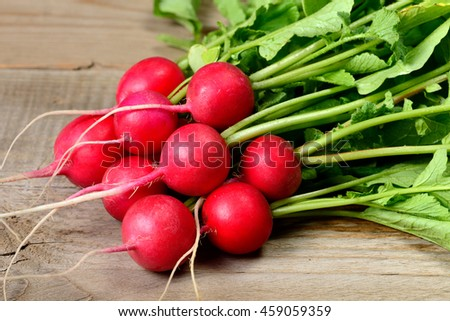 Radishes on wooden table