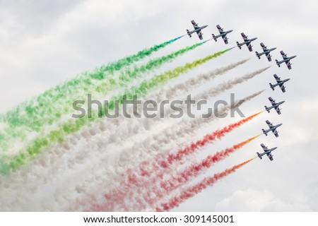 "RADOM, POLAND - AUGUST 23: Aerobatic group formation ""Frecce Tricolori""  italian aerobatic Team at blue sky during Air Show Radom 2015 event on August 23, 2015 in Radom, Poland - stock photo"