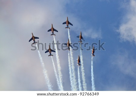 RADOM, POLAND - AUGUST 28: French acrobatic team Patrouille de France during International Airshow on August 28, 2011 in Radom, Poland. - stock photo