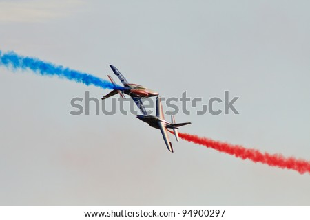 RADOM, POLAND - AUGUST 28: French Patrouille de France acrobatic team performs during the International Airshow on August 28, 2011 in Radom, Poland. - stock photo